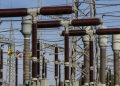 How is electricity distributed in larger areas?